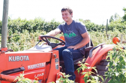 Eric Carney on a tractor